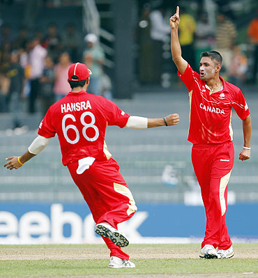 Canada's Harvir Baidwan (right) celebrates with teammate Jimmy Hansra after dismissing Younis Khan