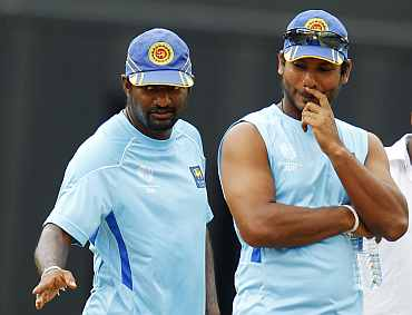 Sri Lanka skipper Kumar Sangakkara and Muralitharan during a practice session