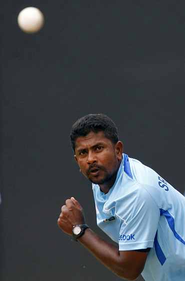 Rangana Herath bowls during a practice session in Colombo