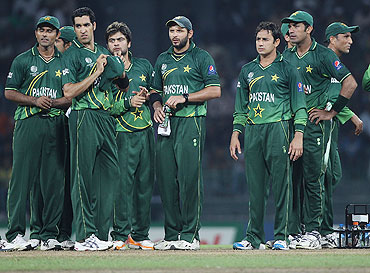The Pakistan team await for a pending wicket appeal