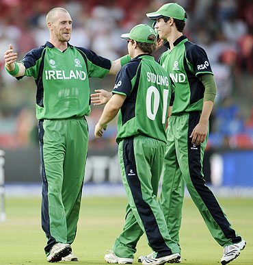 Ireland's John Mooney (left) celebrates with teammates after claiming the wicket of Jonathan Trott on Wednesday