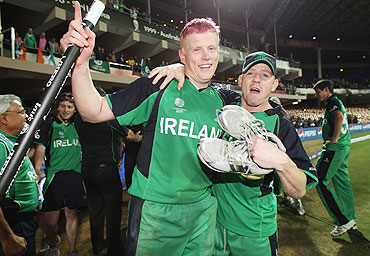 Kevin O'brien celebrates with Nail O'brien after winning his match against England
