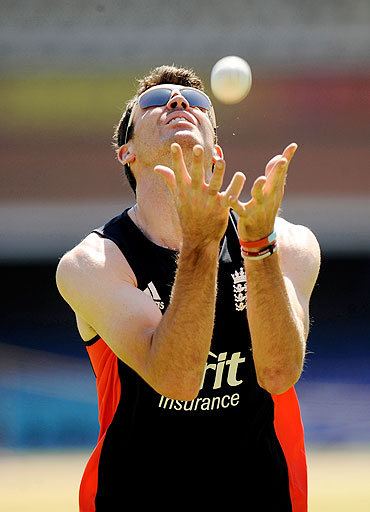 England's James Anderson takes a catch during a practice session