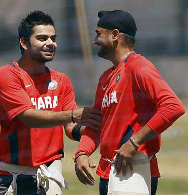 Virat Kohli and Harbhajan Singh takes a break during a practice session in Bangalore