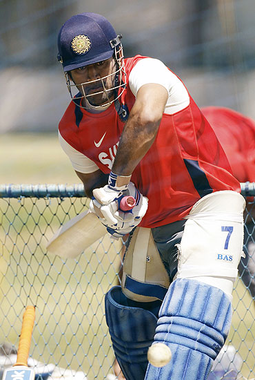 India's captain Mahendra Singh Dhoni hits a shot in the nets during a practice session in Bangalore on Saturday