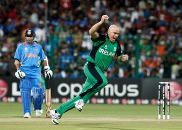 Trent Johnston celebrates a caught and bowled from Sehwag