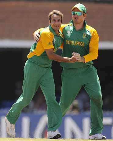 Imran Tahir celebrates after picking up a wicket