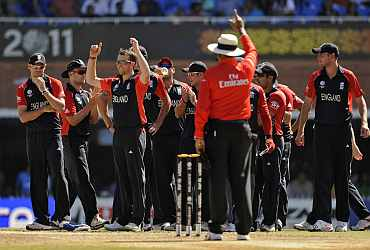 England's players celebrate the dismissal of Smith during their World cup match