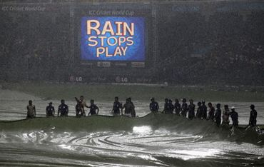 Ground staff at work as rain stops play in the Australia-Sri Lanka match