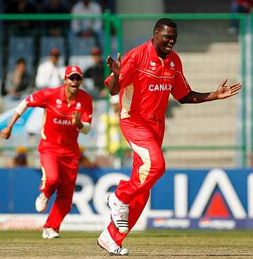 Canada's Henry Osinde celebrates after taking the wicket of David Obuya during the World Cup match