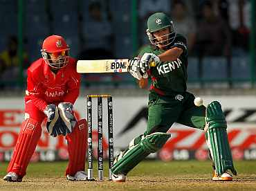 Kenya's Tanmay Mishra hits a shot on the leg side
