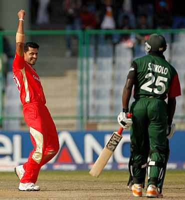 Canada's Rizwan Cheema celebrates after taking the wicket of Kenya's Steve Tikolo during their match