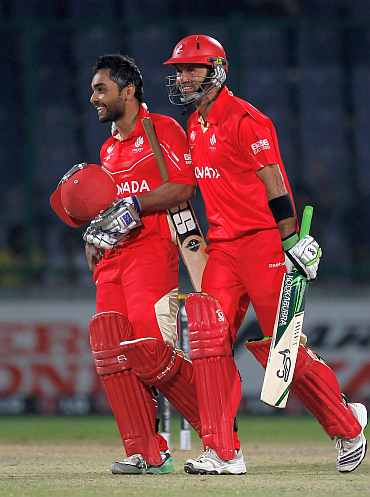 Hansra and Bagai walk back after clinching victory