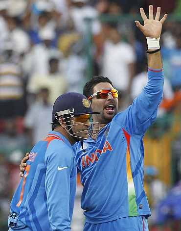 Yuvraj Singh celebrates after picking up a five-wicket haul against Ire