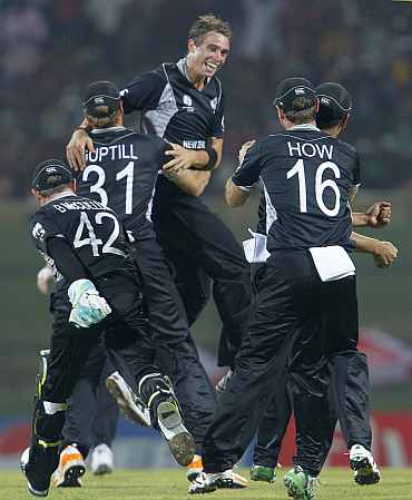New Zealand Tim Southee celebrates with teammates after picking the wicket of Mohammad Hafeez