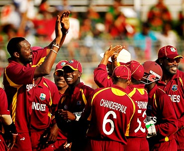 Sulieman Benn celebrates with team mates after taking the wicket of Bangladesh's Rubel Hossain