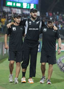 Daniel Vettori being carried off the field