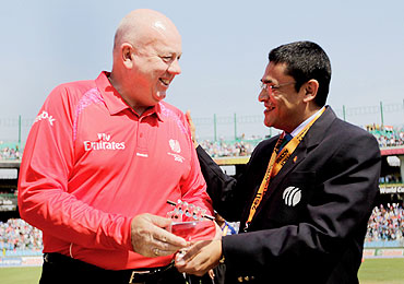 Umpire Steve Davis is presented a memento by Ranjan Madugalle of the Emirates Elite Panel of ICC Match Referees, to mark his 100th One Day International match on Wednesday