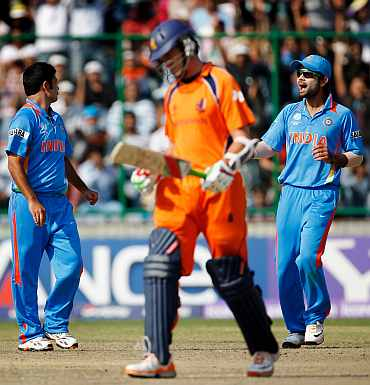 India's Piyush Chawla celebrates after picking up the wicket of Eric Szwarczynski