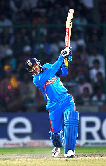 India's Virender Sehwag plays a shot during his knock against Netherlands