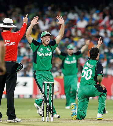 Ireland's George Dockrell (right) celebrates with Ed Joyce after dismissing India's Sachin Tendulkar LBW for 38