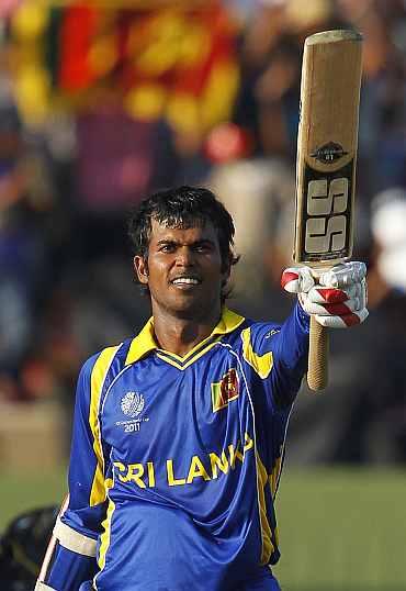 Sri Lanka Upul Tharanga celebrates after completing his century against Zimbabwe