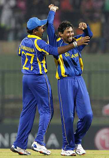Tillakaratne Dilshan celebrates after picking up a wicket against Zimbabwe