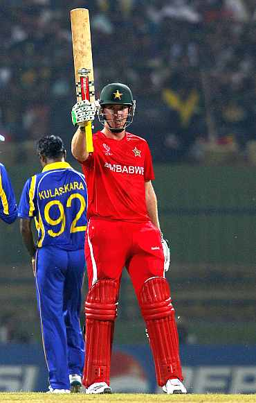 Zimbabwe's Brenddon Taylor celebrates after completing his half-century against Sri Lanka