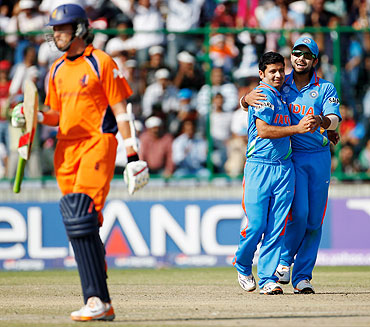 Piyush Chawla of India celebrates with team-mate Virat Kohli