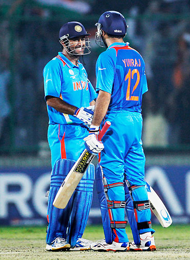 India captain MS Dhoni (left) congratulates teammate Yuvraj Singh on scoring the winning runs against The Netherlands on Wednesday