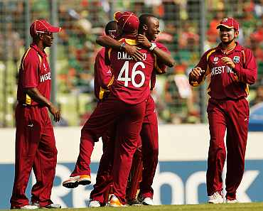West Indies player celebrate after picking up a wicket