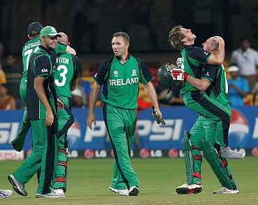 Ireland players celebrate after winning their match