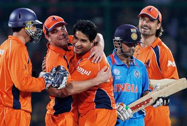 The Netherlands players celebrate the dismissal of Gautam Gambhir