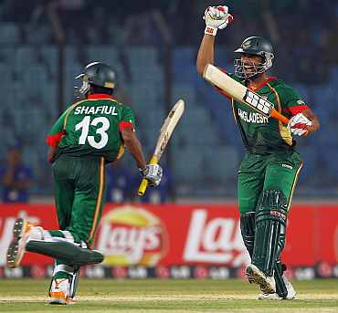 Shafiul and Mahmudullah celebrate after winning their match against England