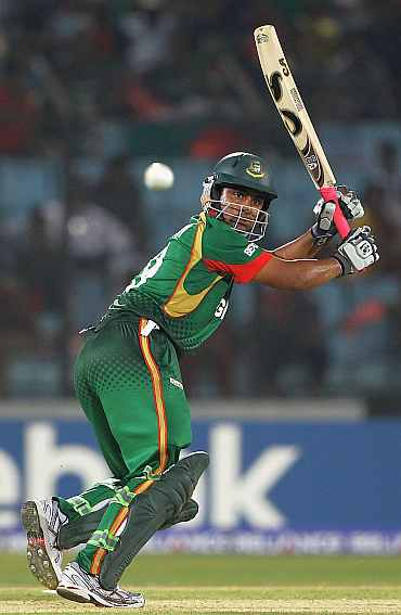 Tamim Iqbal plays a shot during his innings against England