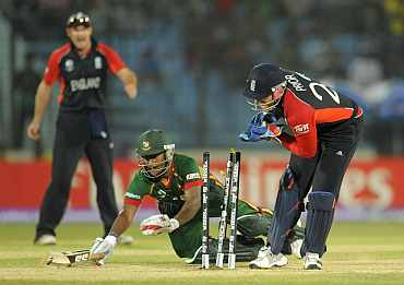 Bangladesh's Imrul Kayes is run out next to England's wicketkeeper Matt Prior during the ICC Cricket World Cup group B match in Chittagong