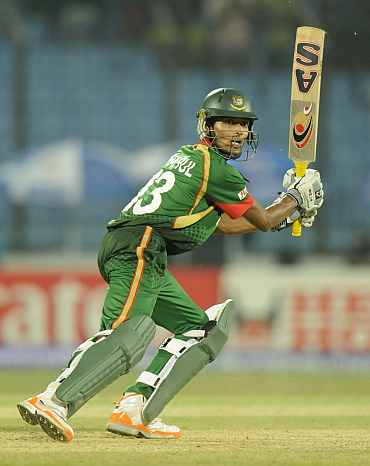 Bangladesh's Shafiul Islam plays a shot during his match against England