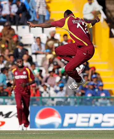 West Indies' Andre Russell celebrates after picking up Ireland's Ed Joyce