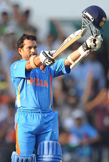 Sachin Tendulkar celebrates after scoring his century