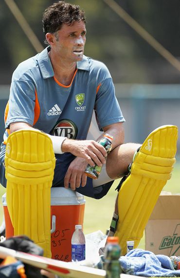 Michael Hussey looks on after batting during nets