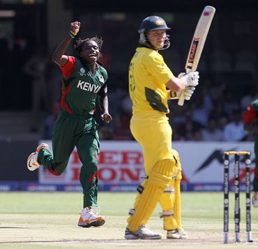 Nehemiah Odhiambo celebrates after taking the wicket of Shane Watson