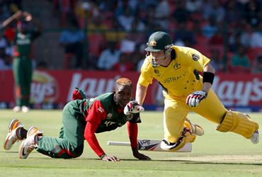 Australia's Brad Haddin and Kenya's Alex Obanda nearly collide during a run-out attempt
