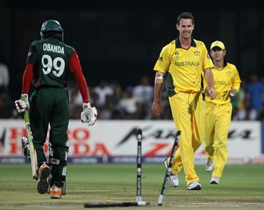 Shaun Tait smiles after bowling Alex Obanda