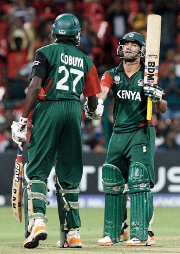 Collins Obuya (L) congratulates Tammay Mishra on scoring 50