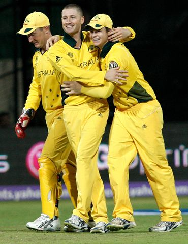 Michael Clarke (C) is congratulated by Steve Smith (R) and Brad Haddin after running out Mishra