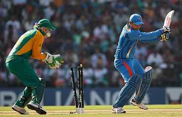 Virender Sehwag is clean bowled by Faf de Plessis