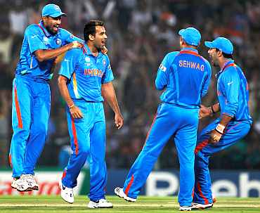 Zaheer Khan celebrates after pickign up the wicket of Graeme Smith