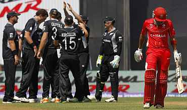 New Zealand players celebrate after a fall of a wicket in Mumbai