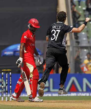 Kyle Mills celebratescelebrates the dismissal of Canada's Gunasekera during their World Cup match