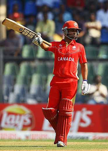 Ashish Bagai celebrates after reaching his half-century